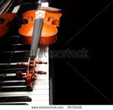 stock-photo-violin-on-the-piano-on-a-black-background-38718436