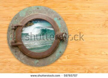 stock-photo-antique-porthole-with-view-of-crashing-waves-on-a-bamboo-wall-background-59765707