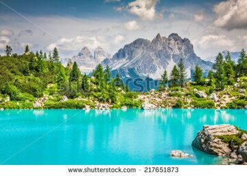 stock-photo-turquoise-sorapis-lake-in-cortina-d-ampezzo-with-dolomite-mountains-and-forest-sorapis-circuit-217651873