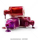 stock-photo-bottles-with-spilled-nail-polish-over-white-background-123473929
