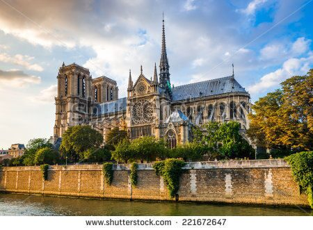 stock-photo-gorgeous-sunset-over-notre-dame-cathedral-with-puffy-clouds-paris-france-221672647