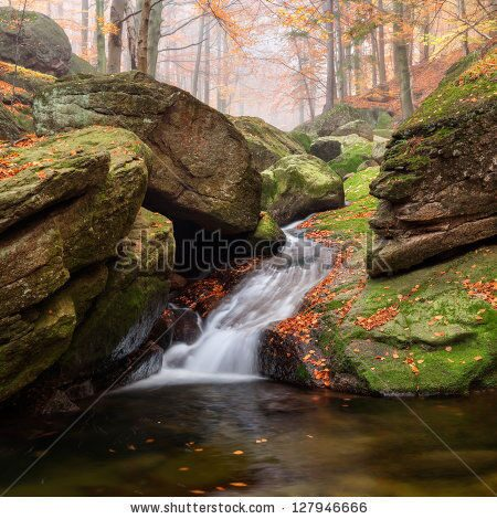 stock-photo-panoramic-view-of-a-beautiful-autumn-waterfall-127946666
