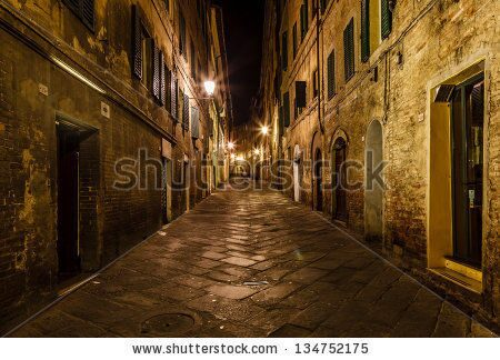 stock-photo-narrow-alley-with-old-buildings-in-medieval-town-of-siena-tuscany-italy-134752175
