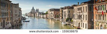 stock-photo-view-of-the-grand-canal-and-the-stunning-baroque-santa-maria-della-salute-church-in-venice-155638679