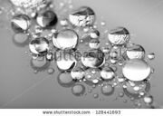 stock-photo-drops-of-on-glass-treat-water-repellent-in-macro-lens-shot-128441693