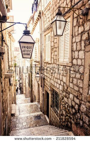 stock-photo-steep-stairs-and-narrow-street-in-old-town-of-dubrovnik-211828594