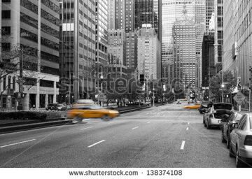stock-photo-manhattan-new-york-city-in-early-morning-with-almost-no-traffic-on-the-street-between-many-138374108