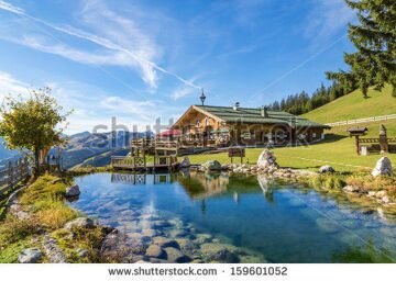 stock-photo-mountain-chalet-with-swimming-pond-159601052