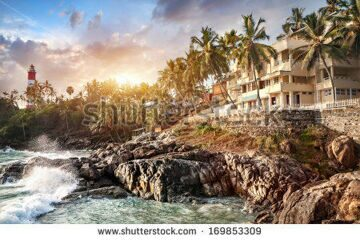 stock-photo-resort-near-the-ocean-at-lighthouse-and-sunset-background-in-tropical-kovalam-kerala-india-169853309