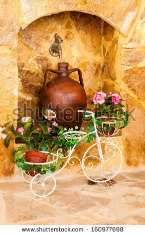 stock-photo-charming-entrance-of-courtyard-of-old-mediterranean-village-spili-160977698