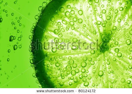 stock-photo-lime-slice-in-water-bubbles-80124172