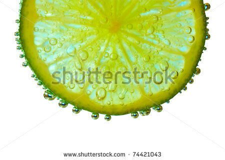 stock-photo-slice-of-lime-with-bubbles-isolated-74421043