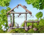 stock-photo-team-of-ants-constructing-wooden-house-in-forest-teamwork-ant-tales-139739617