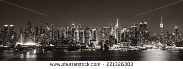 stock-photo-midtown-manhattan-skyline-in-black-and-white-at-dusk-panorama-over-hudson-river-221326303