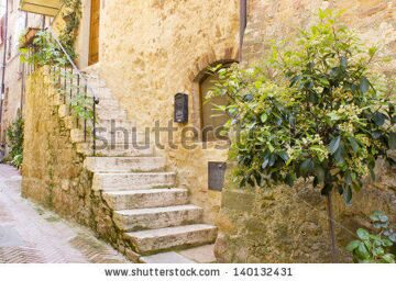 stock-photo-lovely-tuscan-street-pienza-italy-140132431