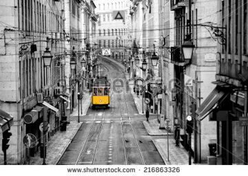 stock-photo-famous-yellow-tram-in-the-streets-of-lisbon-capital-of-portugal-in-the-early-morning-with-no-216863326