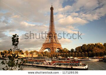 stock-photo-eiffel-tower-with-boat-in-paris-france-117128536