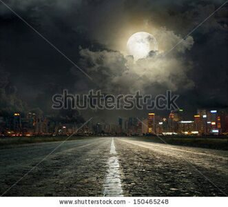 stock-photo-asphalt-road-leading-into-the-city-at-night-150465248