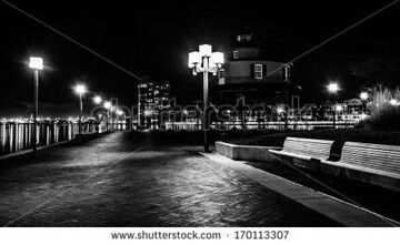 stock-photo-waterfront-promenade-and-lighthouse-at-night-in-the-inner-harbor-baltimore-maryland-170113307
