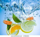 stock-photo-tropical-fruits-fall-deeply-under-water-with-a-big-splash-172984001
