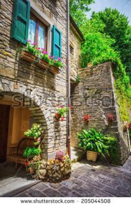stock-photo-typical-italian-street-in-a-small-provincial-town-of-tuscan-italy-europe-205044508