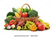 stock-photo-composition-with-vegetables-and-fruits-in-wicker-basket-isolated-on-white-88218493
