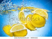 stock-photo-lemon-slices-falling-deeply-under-water-with-a-big-splash-on-blue-background-95004421 (1)