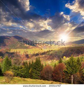 stock-photo-autumn-landscape-village-on-the-hillside-forest-on-the-mountain-light-fall-on-clearing-on-205514797