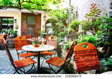 stock-photo-cafe-terrace-in-small-european-city-210089473