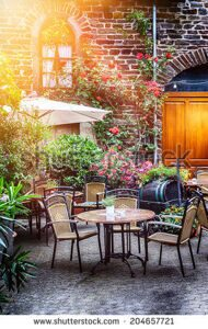 stock-photo-cafe-terrace-in-small-european-city-204657721