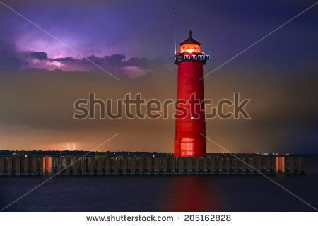 stock-photo-the-kenosha-north-pier-lighthouse-on-wisconsin-s-lake-michigan-coast-shines-brightly-wit