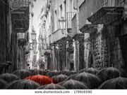 stock-photo-black-and-white-picture-a-lot-of-umbrellas-in-the-same-style-in-a-rainy-street-in-barcelona-179916590