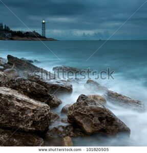 stock-photo-beautiful-nightly-seascape-with-lighthouse-on-the-island-101820505