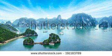 stock-photo-tourist-junks-floating-among-limestone-rocks-at-early-morning-in-ha-long-bay-south-china-sea-191183789