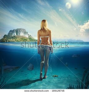 stock-photo-attractive-woman-standing-in-the-blue-water-189126746