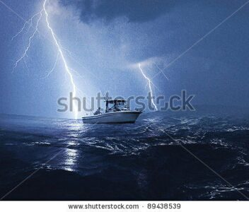 stock-photo-boat-in-lightning-storm-89438539