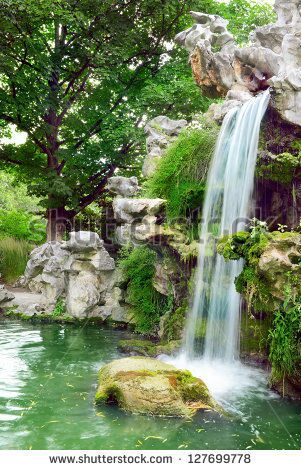 stock-photo-large-waterfall-in-the-park-127699778