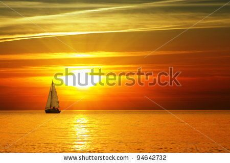 stock-photo-sailboat-on-the-ocean-at-sunset-94642732