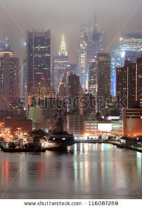 stock-photo-new-york-city-manhattan-midtown-skyline-at-night-with-skyscrapers-over-hudson-river-viewed-from-new-116087269