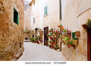 stock-photo-majorca-valldemossa-typical-village-with-flower-pots-in-facades-at-spain-87140668