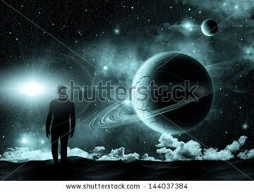stock-photo-man-standing-on-the-background-of-the-cosmic-landscape-144037384