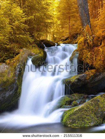 stock-photo-autumnal-landscape-with-waterfall-215511316