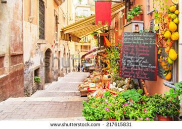 stock-photo-entrance-to-local-shop-in-taormina-sicily-writing-on-the-black-table-lists-itmes-on-promotion-217615831