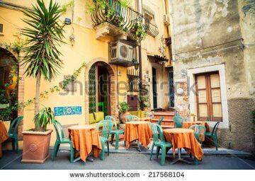 stock-photo-street-cafe-in-the-beautiful-town-taormina-sicily-italy-217568104