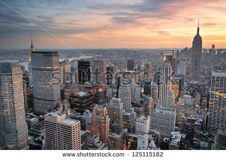 stock-photo-new-york-city-skyline-aerial-view-at-sunset-with-colorful-cloud-and-skyscrapers-of-midto